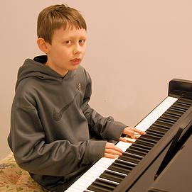 Capron boy has a future tickling the ivories, funny bone