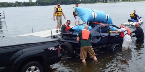Water rescue teams submerge car for training exercise