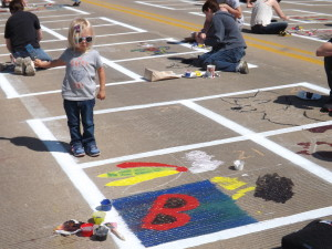 The City of Murals brings younger artists to paint the streets
