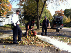 Fire fighters ready city hydrants for winter
