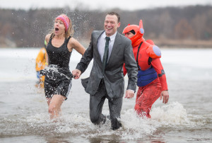Kim Louis (from left), Mark Batty and Ray Gutierrez from Rochelle Community Hospital feel the cold during the annual 2016 Special Olympic Polar Plunge held at Olson Lake in Rockford, IL. on Saturday, Mar. 5, 2016. Erik Anderson | The Post Journal