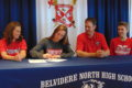 ANNE EICKSTADT PHOTO Belvidere Daily Republican Morgan McNulty signs a Letter of Intent to play golf at Lewis University in Romeoville while her family looks on.