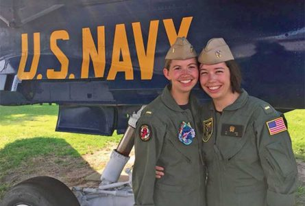 COURTESY PHOTOS Tempo Stillman Valley twins Ashley and Brianna Koenig pose for a picture together in their Navy uniforms.
