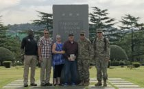 COURTESY PHOTO Belvidere Daily Republican 	Howard is pictured, along with daughter Diane, U.S. servicemen and officers, along with South Korean officers recently when honored in South Korea.