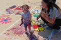 ANNE EICKSTADT PHOTO Belvidere Daily Republican Sophia Shableau, age 1 ½, really gets involved in Paint the Hill as mom Ashley helps.