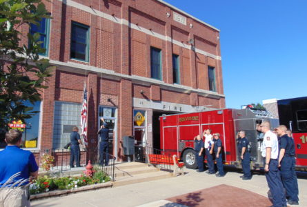 ANNE EICKSTADT PHOTO Belvidere Republican BFD firefighters salute as the Ground Zero flag is raised.