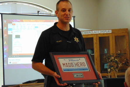 ANNE EICKSTADT PHOTO Belvidere Republican Detective Kozlowski has been given an award for his work from Mothers Against Drunk Driving. He keeps it in a place of honor at his home.
