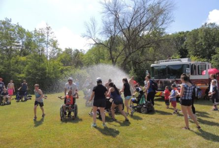 COURTESY PHOTO Belvidere Republican Visiting firefighters camp to encourage and splash the kids at MDA Camp this summer.