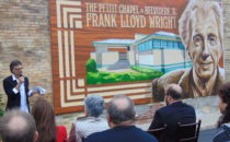 ANNE EICKSTADT PHOTO Belvidere Republican Jay Robert Allen brings together the hometown and the artist's perspectives and expresses his pride in Belvidere at the Pettit Chapel mural dedication ceremony.