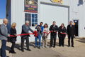 ANNE EICKSTADT PHOTO Belvidere Republican 	Mayor Mike Chamberlain and members of the busi-ness community join Mike and Julie Borowicz in cele-brating the opening of Rite on Time Design's new Belvidere location.