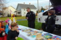 ANNE EICKSTADT PHOTO Belvidere Republican Officer Tim Blankenship and Officer Julie Kirk meet costumed kids in the community with candy and books the kids can keep.