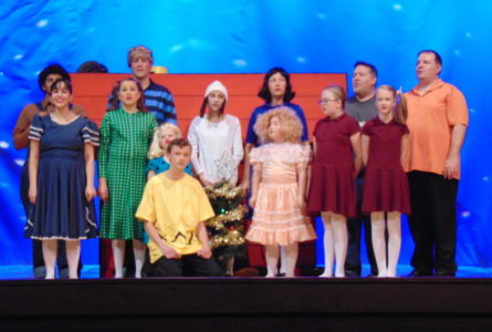 ANNE EICKSTADT PHOTO Belvidere Republican The cast of 'A Charlie Brown Christmas' gather around the Christmas tree to sing.