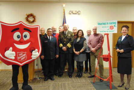 ANNE EICKSTADT PHOTO Belvidere Republican The Salvation Army Red Kettle Kickoff drew Belvidere dignitaries to support efforts to raise money for the hungry and disadvantaged in the area.