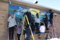 SUBMITTED PHOTO Belvidere Republican Students diligently repaint the VFW mural to its original clear, bright colors.