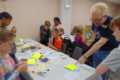 ANNE EICKSTADT PHOTO Belvidere Republican Norm Knott discusses creative uses of found objects with fifth graders during his Junk Art class during the Fifth Grade Arts Festival at the Community Building Complex.