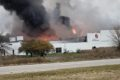 COURTESY PHOTOS Belvidere Republican The fire at FPM Heat Treat was clearly seen early on as it broke through the roof of the building.