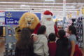 ANNE EICKSTADT PHOTO Belvidere Republican A group of kids at Walmart discover the Lions' mascot and Santa Claus strolling the aisles.