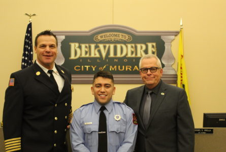 ANNE EICKSTADT PHOTO Belvidere Republican Chief Al Hyser and Mayor Mike Chamberlain join firefighter Adrian Trujillo, as Trujillo takes his Oath of Office to protect the community on Friday, Jan. 11.
