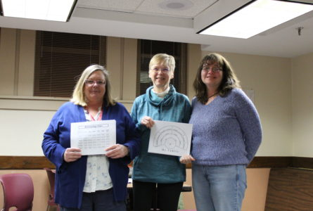 ANNE EICKSTADT PHOTO Belvidere Republican Mindy Long, history specialist at the Ida Public Library and Marsha Hosfeld, genealogy expert with Denise Rottmann, seeker of her family tree information at an informal, drop-in genealogy evening.