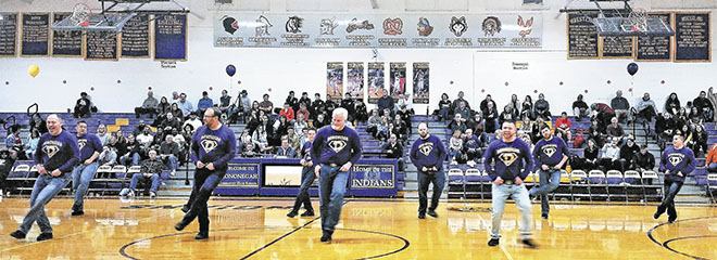 Dancing Dads wow crowd at HHS basketball half-time performance