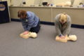 ANNE EICKSTADT PHOTO Belvidere Republican 	Members of Beck's CPR class practice doing compressions on CPR mannequins.