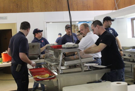 ANNE EICKSTADT PHOTO Belvidere Republican The Boone County Fire District 2 Firefighters Association serves a sumptuous pancake breakfast with all the trimmings to the community of Poplar Grove.