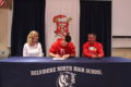 ANNE EICKSTADT PHOTO Belvidere Republican 	Tanner Matteus signs a Letter of Intent to play football for Benedictine University while his parents watch in approval.