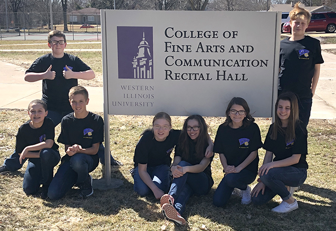 Choir students sing at Western Illinois University
