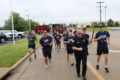SUBMITTED PHOTOS Belvidere Daily Republican 	Police Chief Woody takes the lead with the official torch in hand as the run begins.