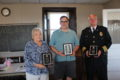 ANNE EICKSTADT PHOTO Belvidere Republican 	Colleen Leach, Wayne Zelasko, and Deputy Chief Bob Koehn hold their awards proudly.