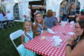 ANNE EICKSTADT PHOTOS Belvidere Republican 	Little Miss Boone County Marrah Jayde Vander Vennet and Boone County Queen Emily Carter are loving the pie, cake, and ice cream at the Boone County Historical Museum's Ice Cream Social.