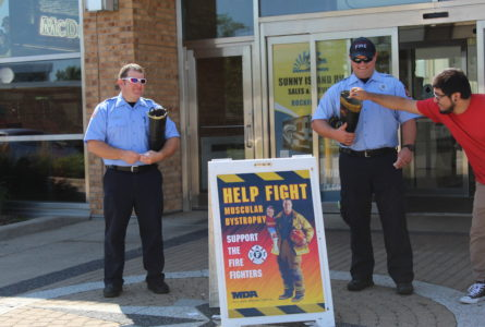 ANNE EICKSTADT PHOTOS Belvidere Republican Firefighters Swanson and Winnie collected for the Fill the Boot for MDA campaign at the Belvidere Oasis on Labor Day.