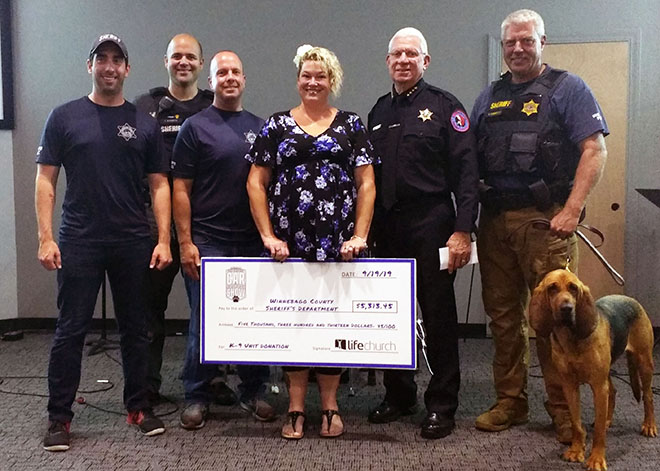 Life Church in Roscoe presents donation to Winnebago County Cops, Cars and K9s