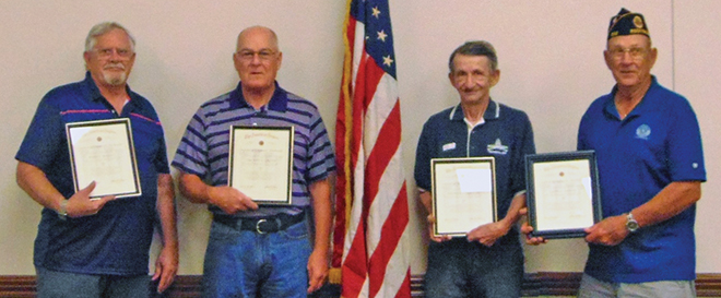 American Legion receives gifts of flag, AED; recognizes members