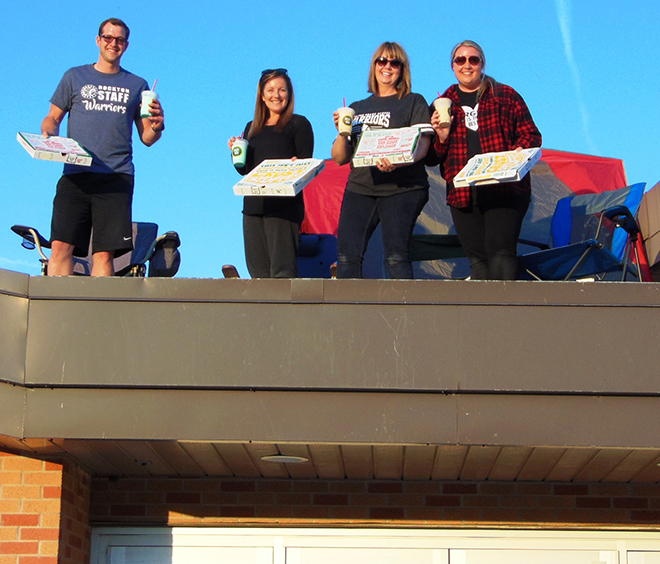 Students exceed fun run goals, Principals camp on roof as reward